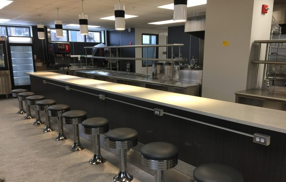Inside the new Gigi's Northland, a row of stools will give diners a place to recharge – and charge their phones. (Andrew Galarneau/Buffalo News)