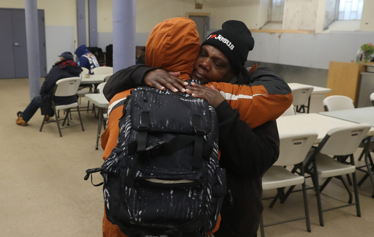 Charlene Mallory, an associate missionary at St. Luke's, gives a hug to a man seeking shelter from the cold during a Code Blue situation at St. Luke's Mission of Mercy. (John Hickey/Buffalo News)