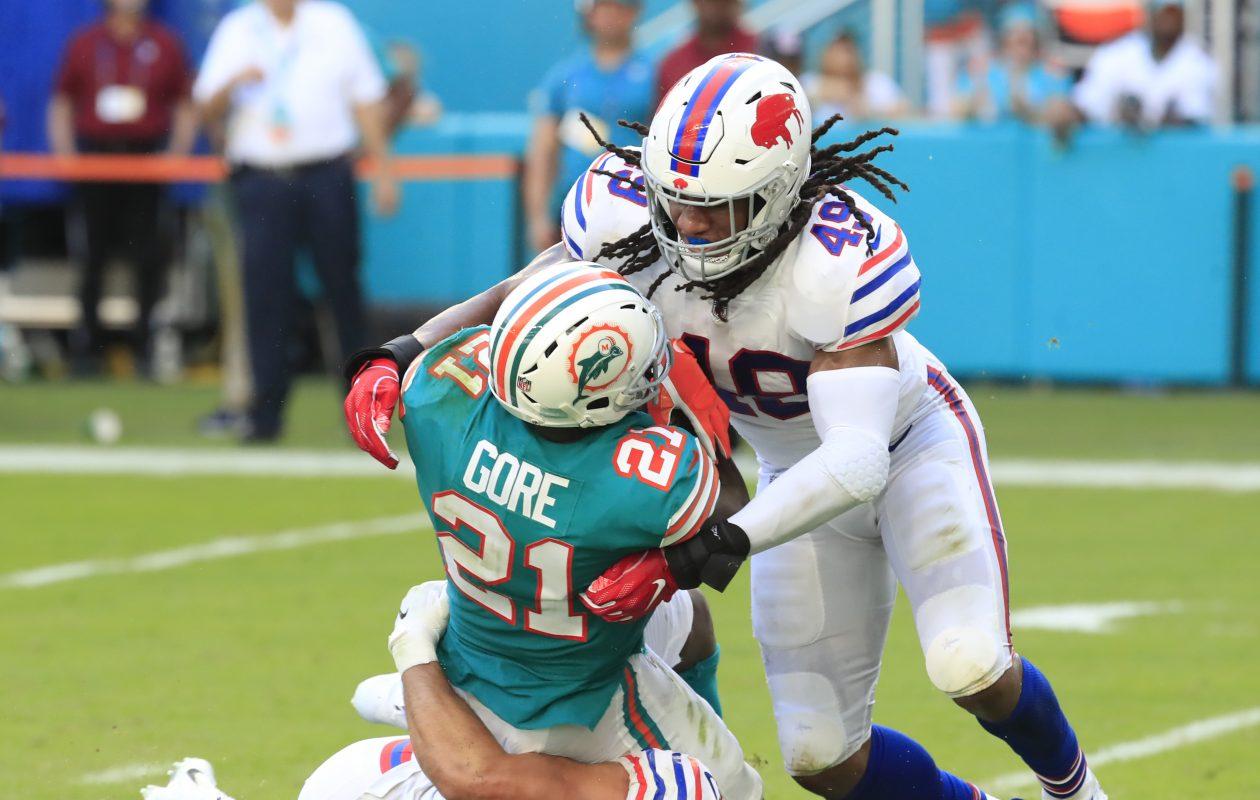 Bills linebackers Matt Milano and Tremaine Edmunds tackle Dolphins running back Frank Gore on Sunday, Dec. 2, 2018. (Harry Scull Jr./Buffalo News)