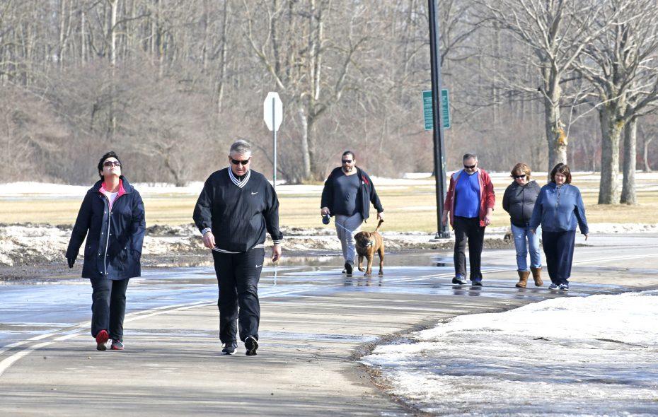 Pat and Meghan Driscoll of South Buffalo joined walkers in Cazenovia Park in South Buffalo on Monday, Feb. 4, 2019.  (Robert Kirkham/Buffalo News)