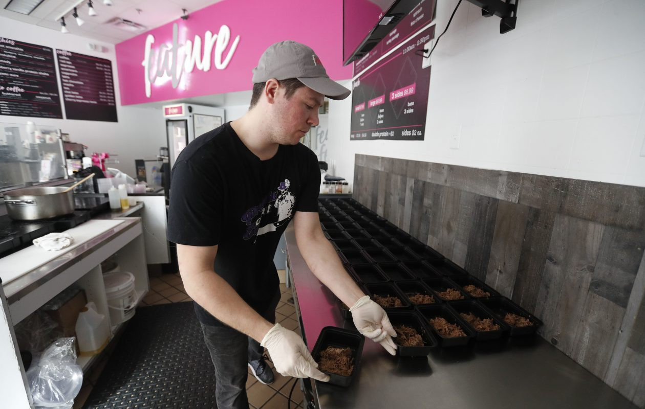 Justin Tartick plates some braised beef and quinoa at Feature in Buffalo. (Mark Mulville/Buffalo News)