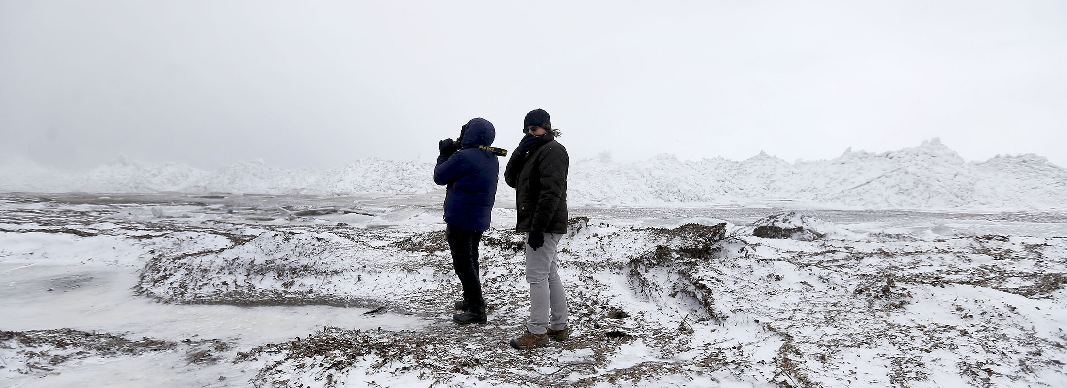 Mike Niman and Laura McClusky explore Woodlawn Beach State Park in Blasdell on a chilly February day.  (Mark Mulville/News file photo)