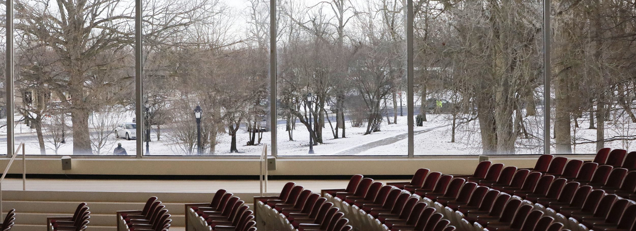 A Delaware Park snowscape can be seen through the huge windows of the Albright-Knox Art Gallery auditorium on Friday, Jan. 11, 2019. (Derek Gee/Buffalo News)