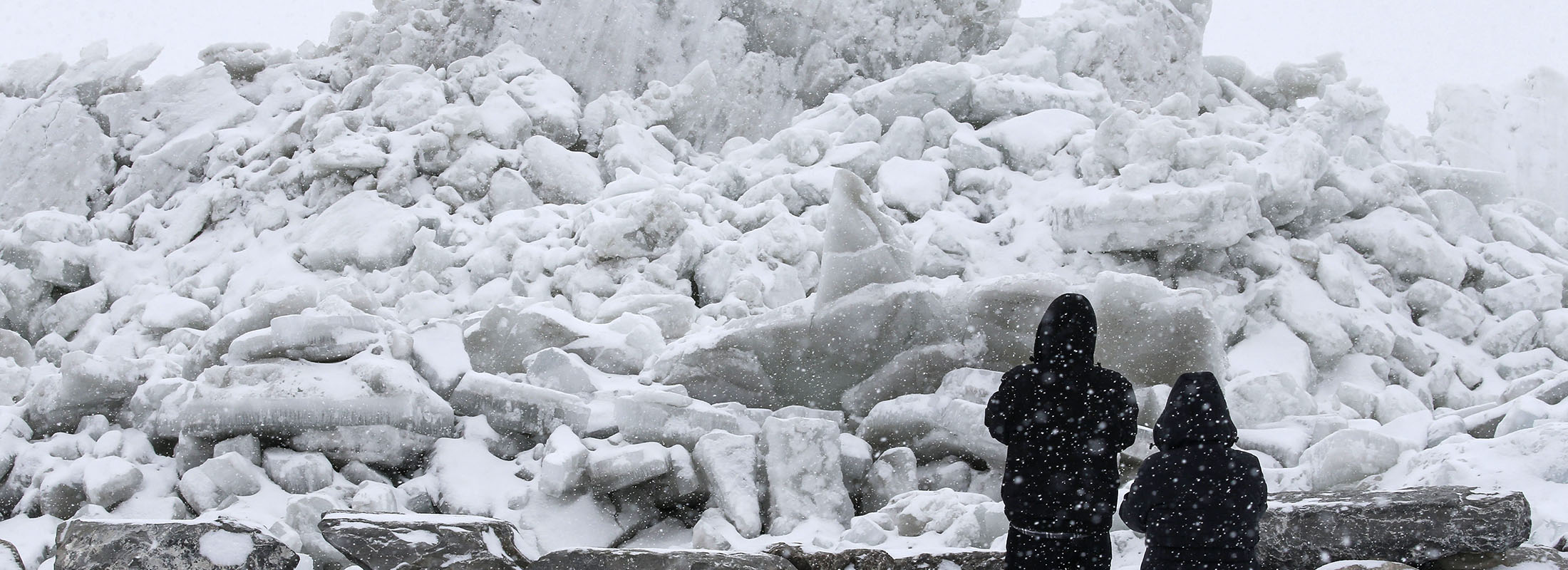 Onlookers check out the mountains of ice left on Hoover Beach. (Derek Gee/News file photo)