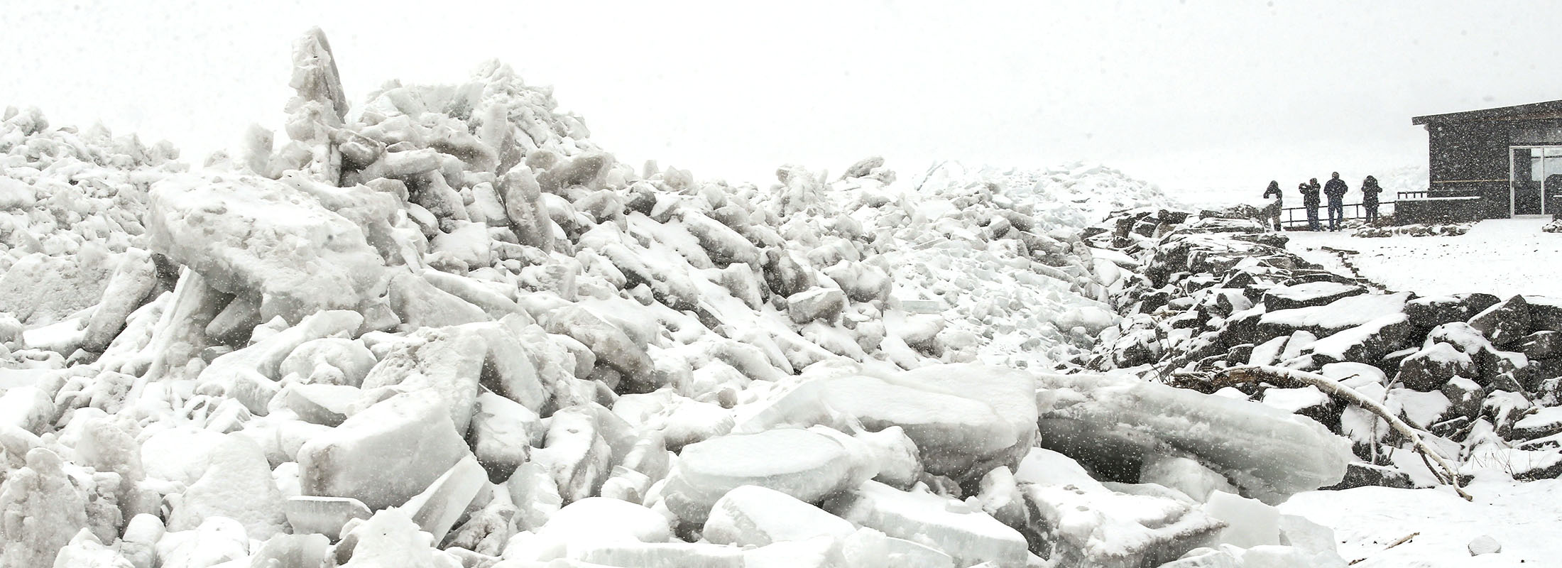 Onlookers check out the mountains of ice left on Hoover Beach after the past week's windstorm. (Derek Gee/Buffalo News)