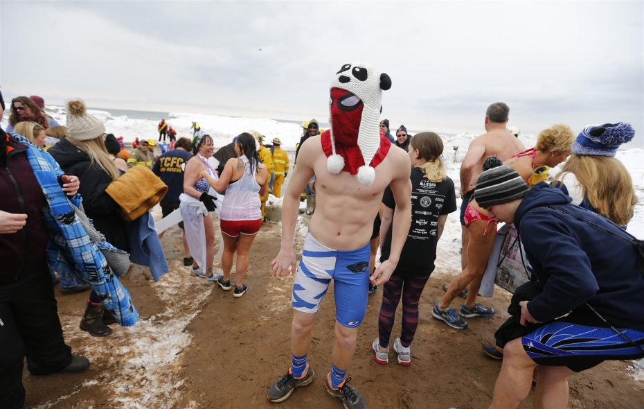 Hundreds brave icy waters for 50th Polar Bear Swim