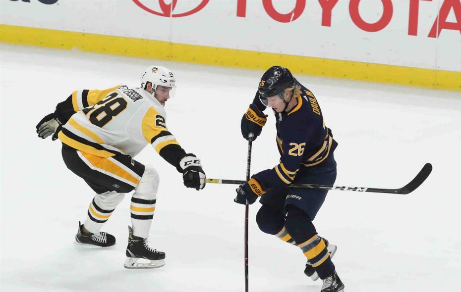 Buffalo Sabres defenseman Rasmus Dahlin attempts to stick-handle around Pittsburgh Penguins defenseman Marcus Pettersson in overtime Friday night in KeyBank Center. (James P. McCoy/Buffalo News)