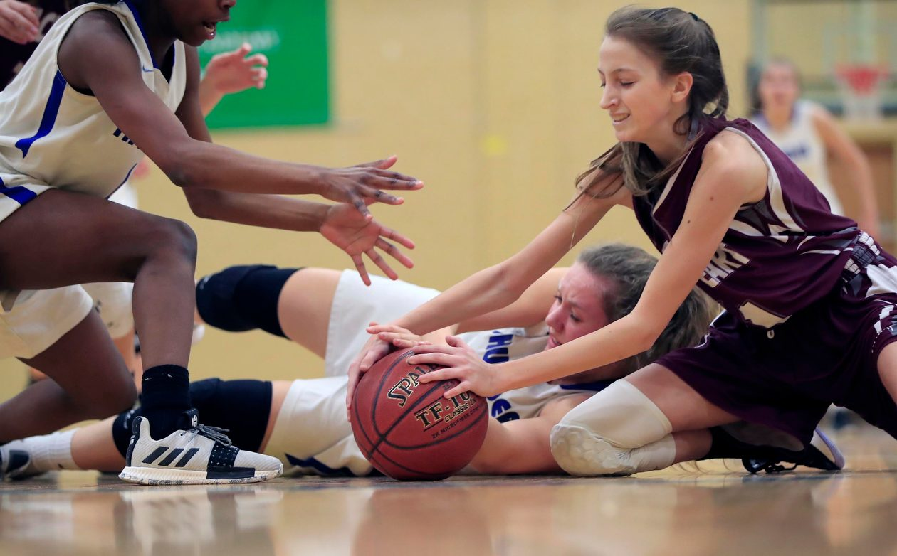 Mt. St. Mary's defender Lauren Mucia and Sacred Heart's Morgan Giancaterino battle for a loose ball during the Monsignor Martin Class A girls final at Villa Maria College on Friday, March 1, 2019. (Harry Scull Jr./Buffalo News)