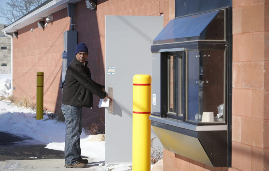 Ahmed Saleh, owner of Mandella Market on Broadway, enters the empty shop and drive-thru he built in anticipation of getting a Tim Hortons that has yet to materialize. (Derek Gee/Buffalo News)