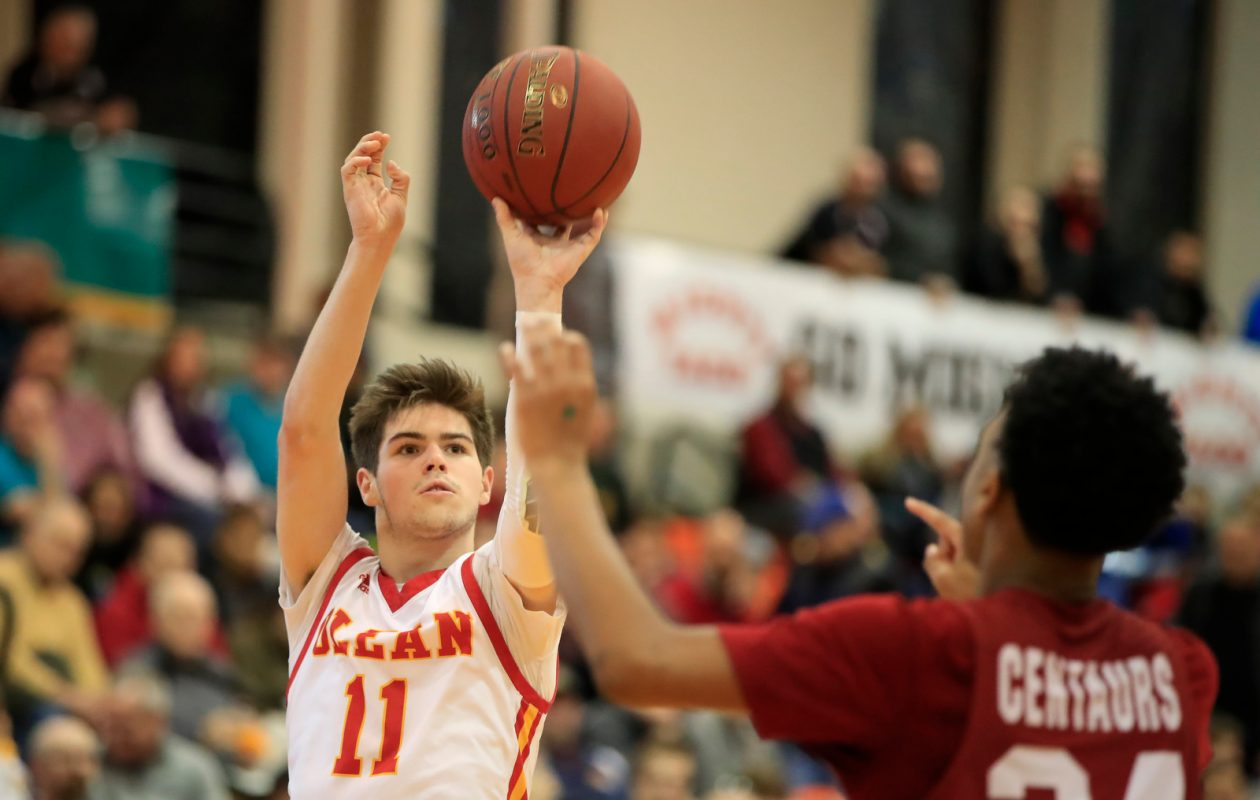 Olean guard Mike Schmidt fires a shot  against City Honors during the second half on Saturday. (Harry Scull Jr./Buffalo News)