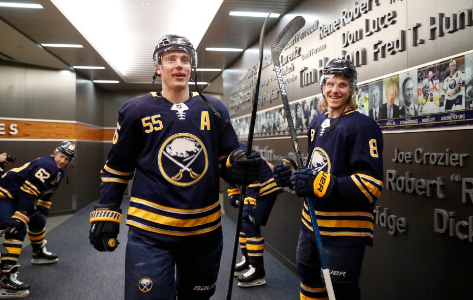 Rasmus Ristolainen, left with Casey Nelson prior to a game in March, was not traded during the offseason. (Harry Scull Jr./News file photo)