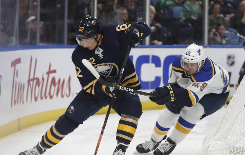 Buffalo Sabres Brandon Montour tries to get the puck past St. Louis Blues player Vince Dunn in a game in March. (Mark Mulville/Buffalo News)