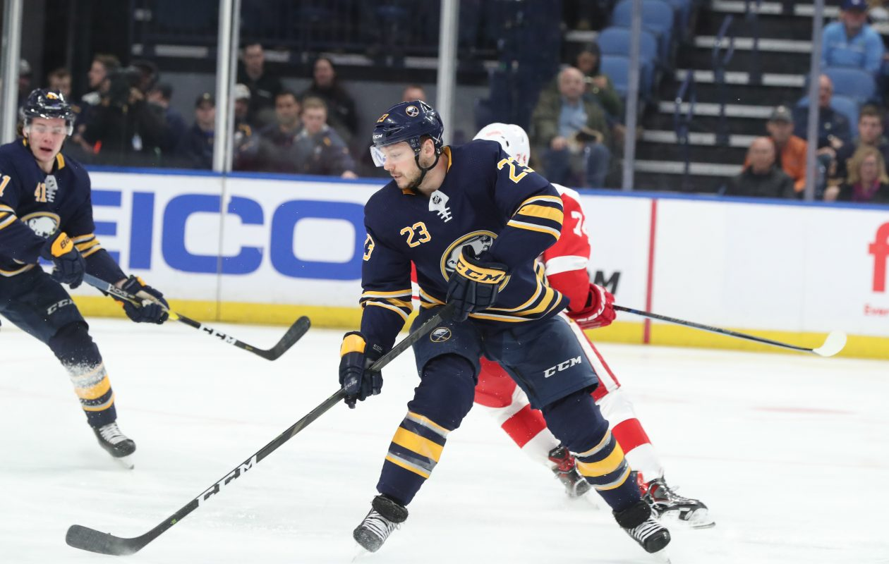 Buffalo Sabres center Sam Reinhart (23) steals the puck away from Detroit Red Wings defenseman Madison Bowey (74) in the first period at Key Bank Center in Buffalo, NY on Thursday, March 28, 2019.  James P. McCoy/Buffalo News