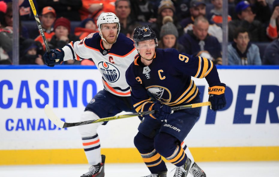 Connor McDavid, left, and Jack Eichel battle for position in the first period Monday night in KeyBank Center (Harry Scull Jr./Buffalo News).