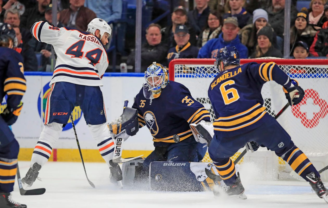 Sabres goaltender Linus Ullmark makes a save on Oilers' Zack Kassian during the first period at KeyBank Center on Monday, March 4, 2019. (Harry Scull Jr./Buffalo News)