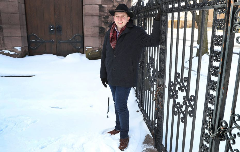 Brad Hahn, executive director of Explore Buffalo, dresses for the weather while being photographed for Fashion Friday outside First Presbyterian Church at Symphony Circle. Explore Buffalo's office is inside the church. (Sharon Cantillon/Buffalo News)