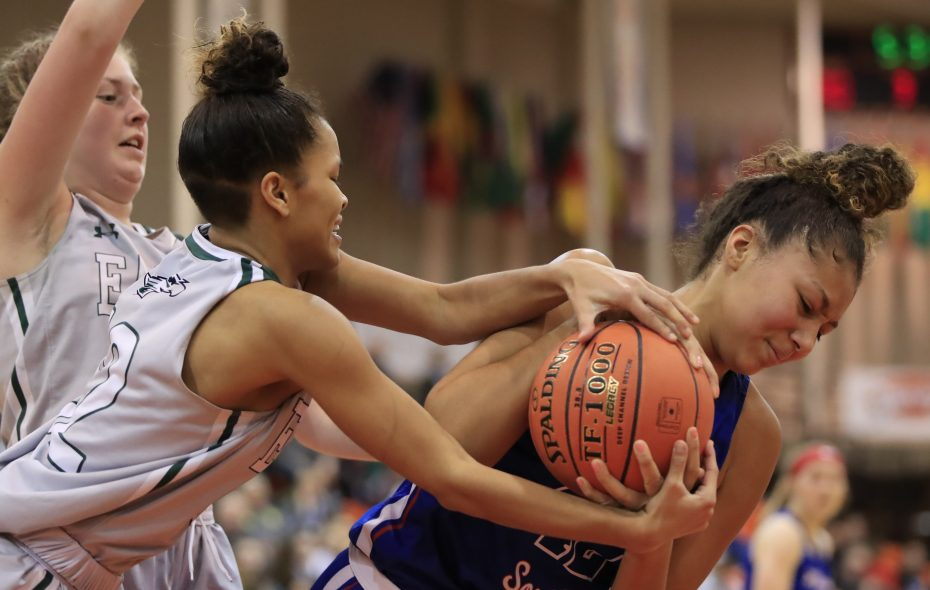 Williamsville South center Amaria DeBerry and Lake Shore guard Tashawni Cornfield battle for a ball during the second half of the VI Class-A Championship at the Buffalo State Sports Arena on Wednesday, March 6, 2019. (Harry Scull Jr./Buffalo News)