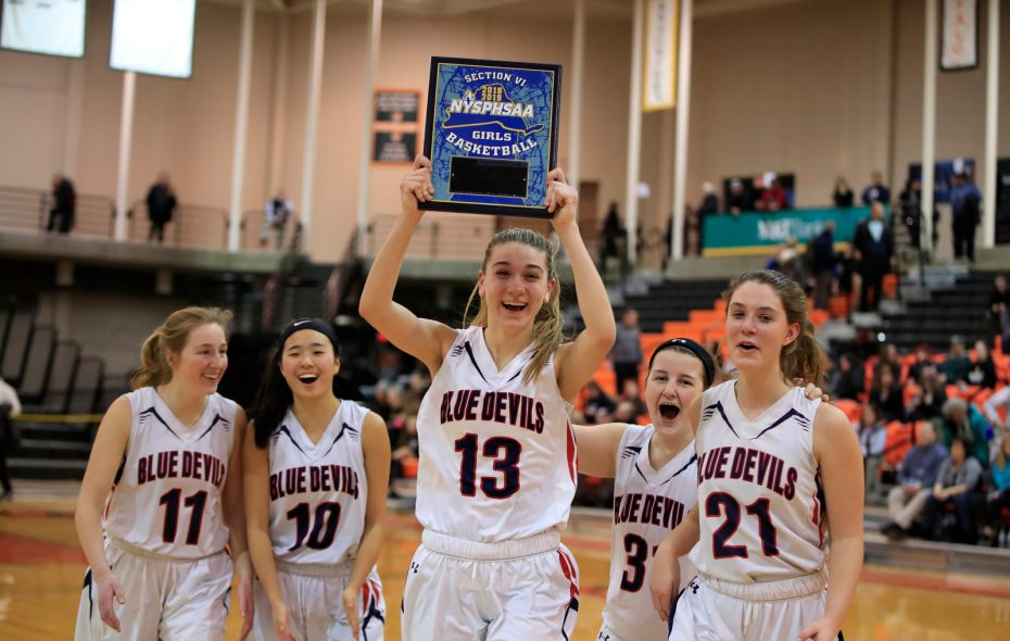 East Aurora's Sarah Tully and her teammates celebrate the Blue Devils' victory over Southwestern in the Class B championship game at SUNY Buffalo State Wednesday. (Harry Scull Jr./Buffalo News)
