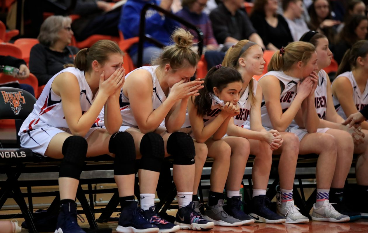 East Aurora players sit on the bench during the closing seconds of a loss to Midlakes during the second half of the Far West Regional Class B Championship on Saturday, March 9, 2019, at the Buffalo State Sports Arena. (Harry Scull Jr./Buffalo News)