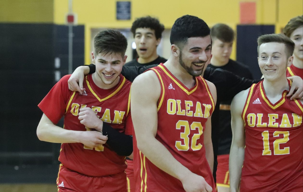 Olean celebrates after beating Greece Odyssey 61-47 to win the Class B Far West Regionals. (James P. McCoy/Buffalo News)
