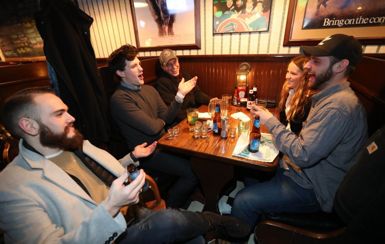 A group of Clarence alumni hangs out at Brennan's. From left are Patrick McCabe, Conner Marquart, Daniel Woodrow, Katie Mazur and Jim Manz. (Sharon Cantillon/Buffalo News)