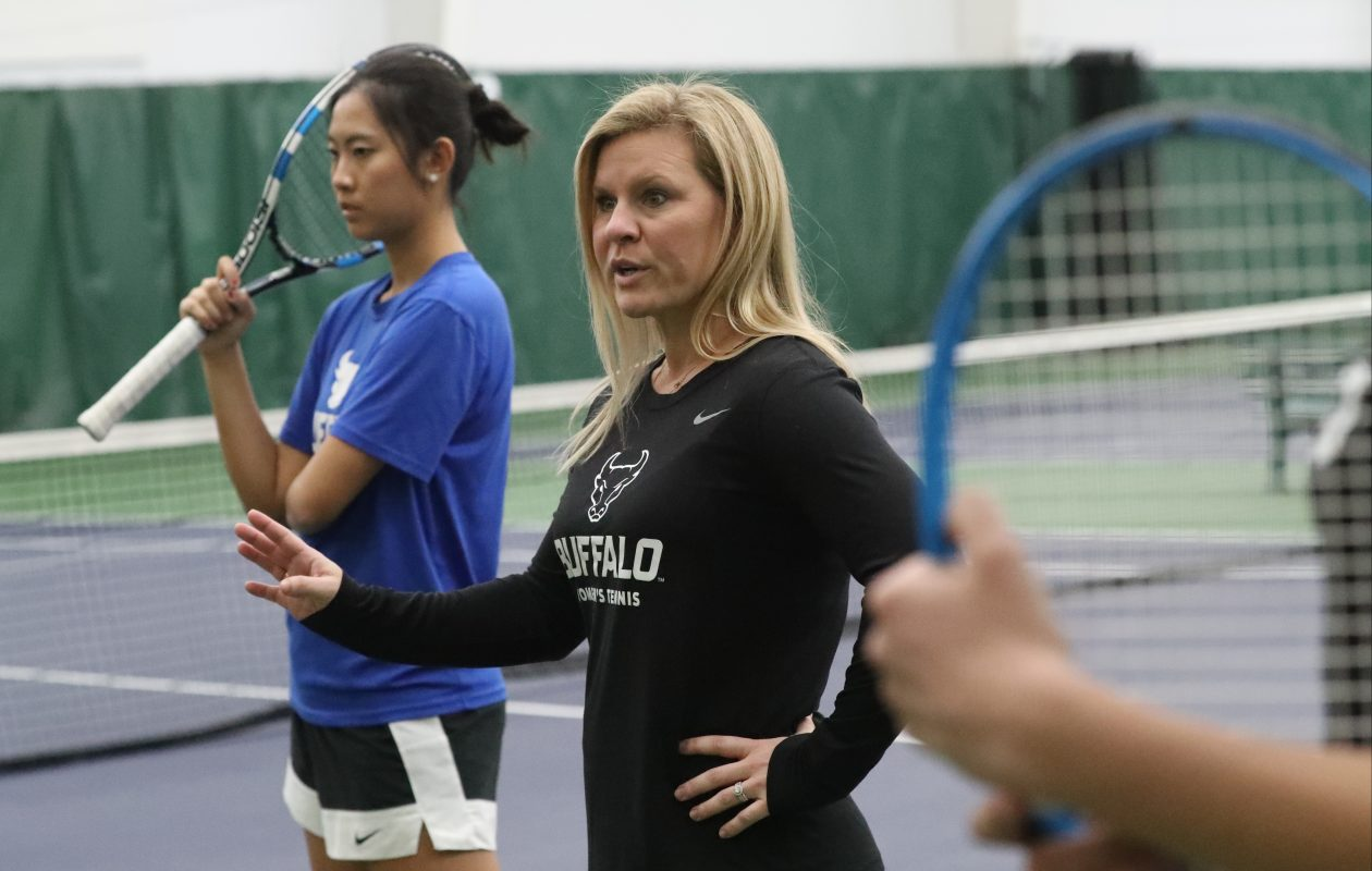 UB's head coach tennis coach Kristen Ortman Maines instructs her players during practice (James P. McCoy/Buffalo News)