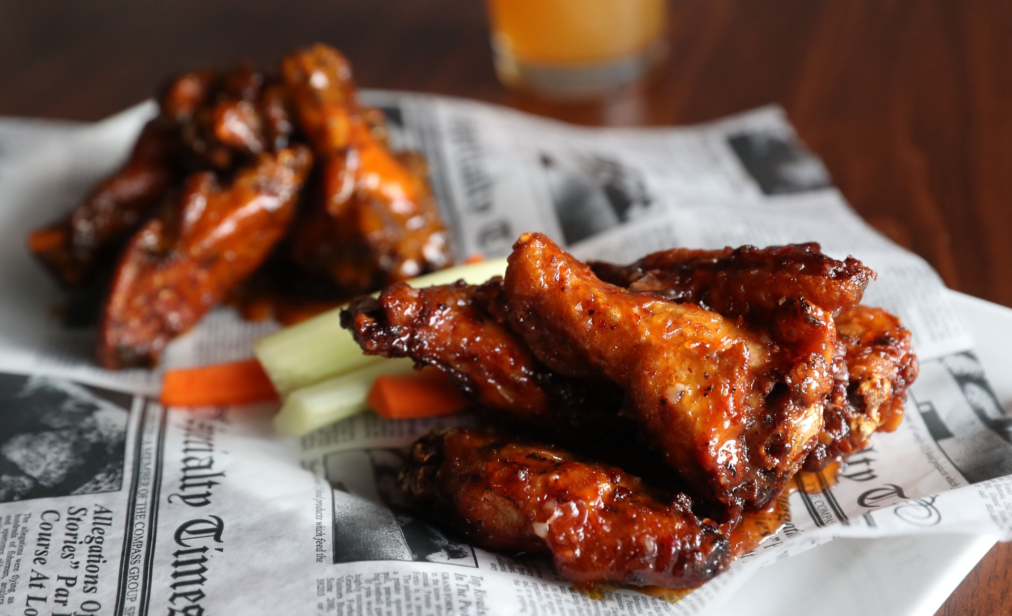 Tony Conrad's Buffalo chicken wings are house rubbed and house smoked at Hilltop. From left are their golden barbecue and sweet chile wings. (Sharon Cantillon/Buffalo News)