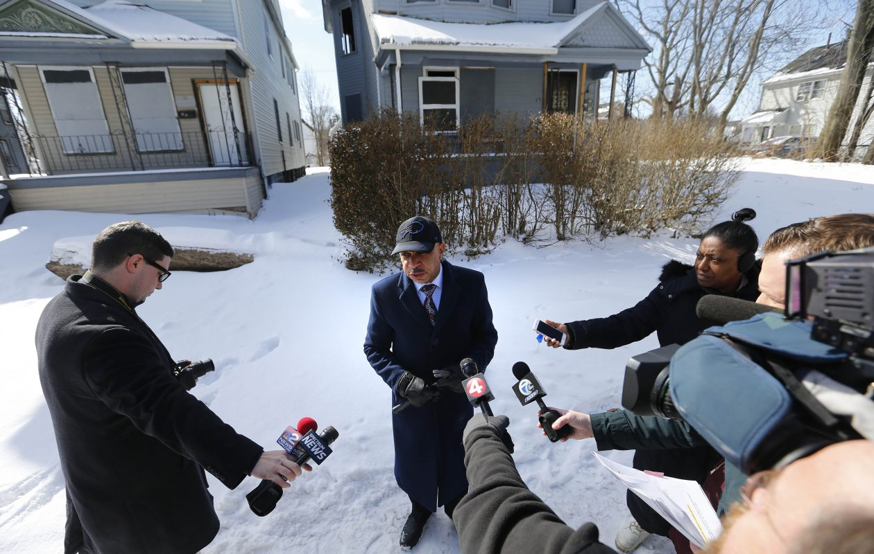 Buffalo Common Council President Darius Pridgen talks with reporters about installing Operation Slumlord signs in front of long-vacant houses on Thursday.      (Mark Mulville/Buffalo News)