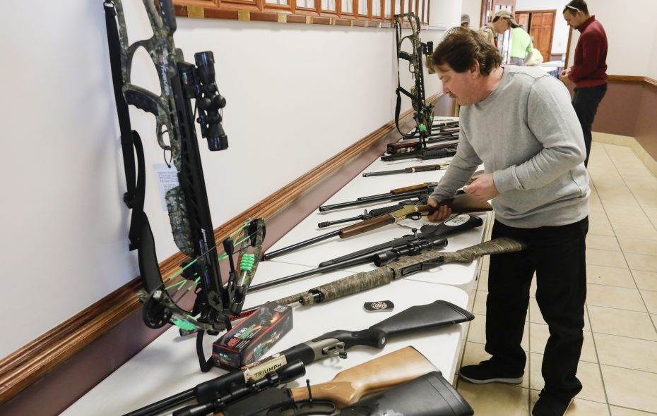 Michael Mancuso of Holland checks out some of the firearms offered during a gun raffle at the Jamison Road Volunteer Fire Company in Elma on Saturday, March 9, 2019. (Derek Gee/Buffalo News)
