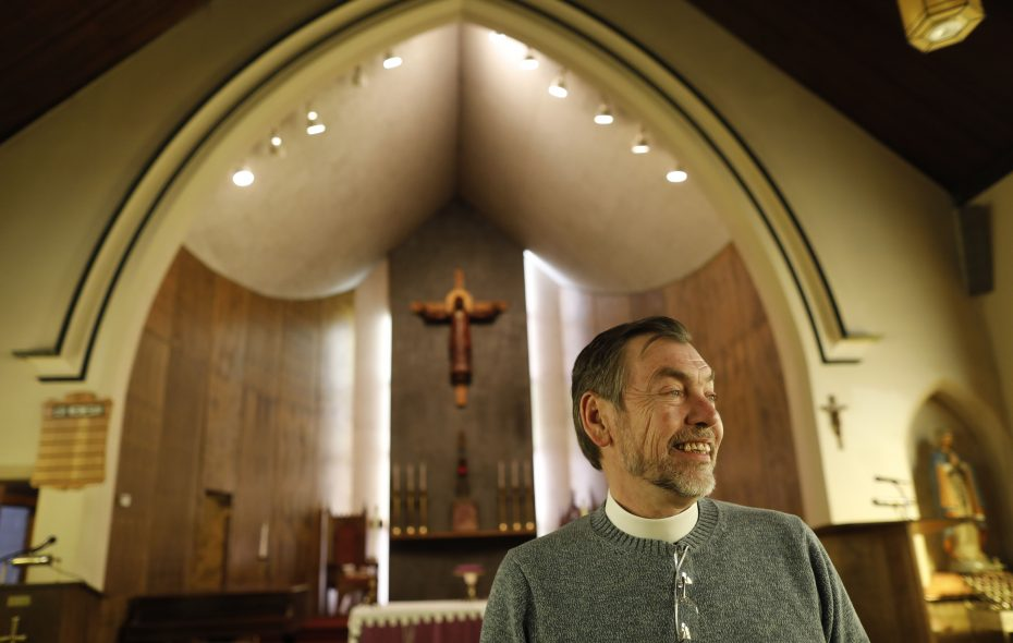 Pastor Stephen Lane has gone from running a pet store to becoming the new pastor of St. Philip's Episcopal Church. (Derek Gee/Buffalo News)