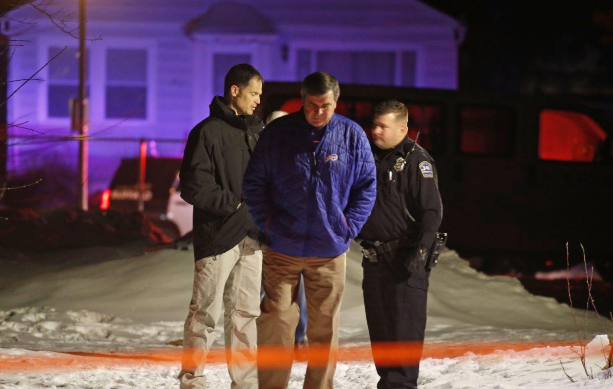 Detectives investigate the scene of a shooting near the Robert M. Ryan North Buffalo Community Center on Friday night. (Robert Kirkham/Buffalo News)