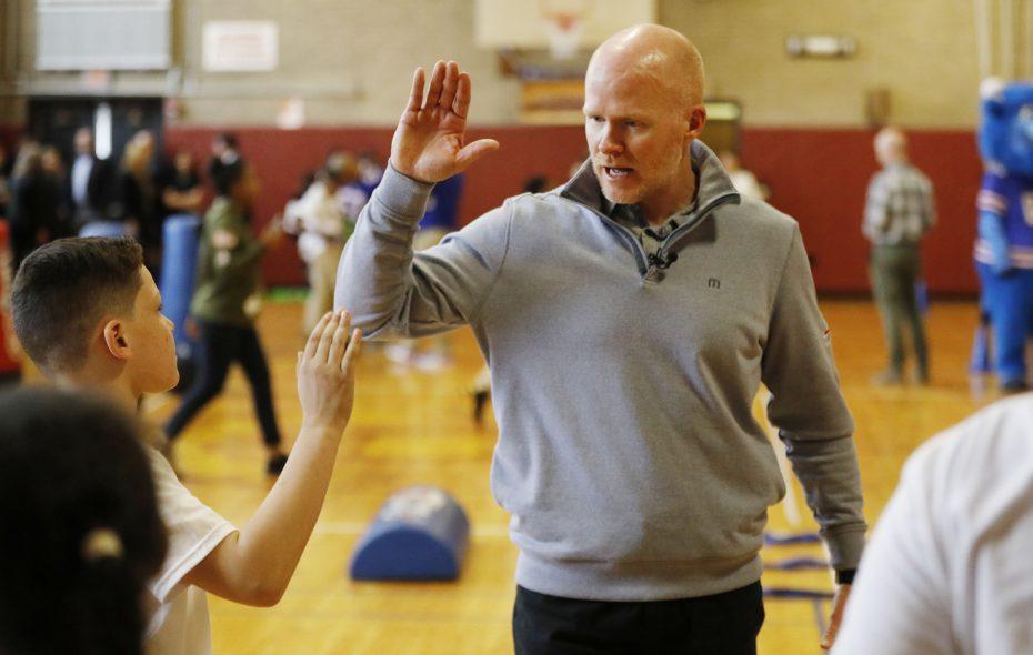 Bills head coach Sean McDermott gives a high-five to fourth grader Jayden Holliday, 9, during an activity at Highgate Heights Elementary School. (Derek Gee/Buffalo News)