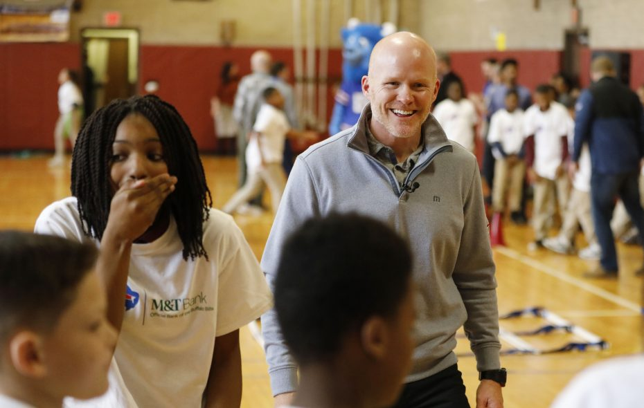 Buffalo Bills head coach Sean McDermott and sixth-grade student Layla Quiles, 11, left, react to Quiles' throw during a quarterback drill during an activity at Highgate Heights Elementary School. (Derek Gee/Buffalo News)