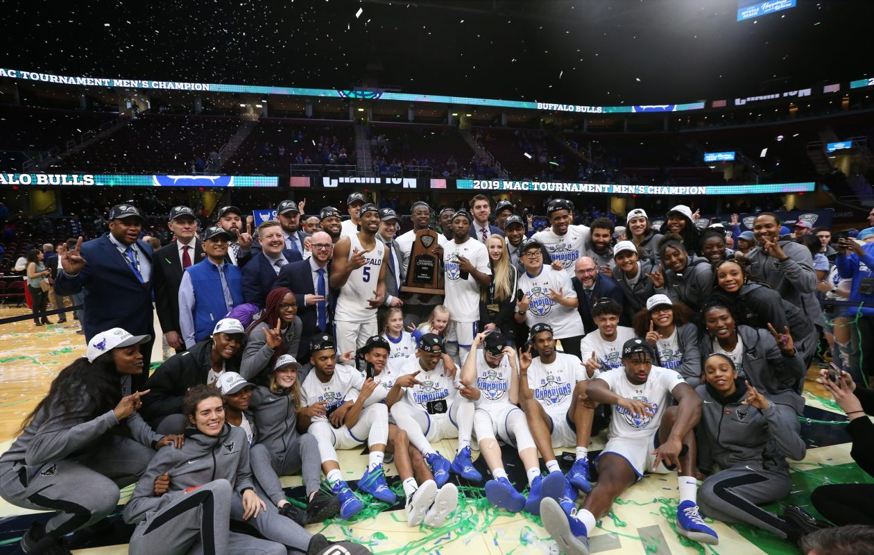 UB's men's and women's basketball teams celebrate after the men defeated Bowling Green to win the MAC Tournament title. (James P. McCoy/Buffalo News)