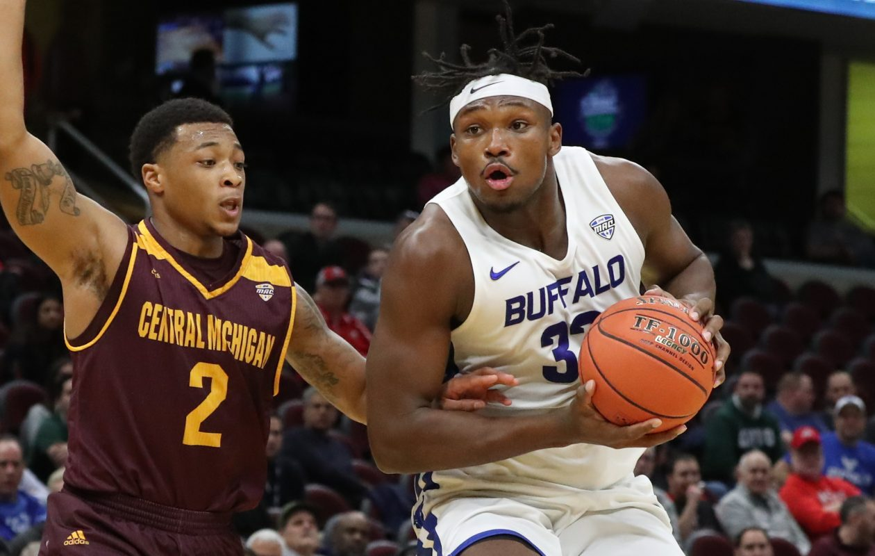 Buffalo Bulls forward Nick Perkins is guarded by Central Michigan Chippewas guard Shawn Roundtree in the first half of the MAC Tournament semifinals at Quicken Loans Arena in Cleveland on Friday, March 15, 2019. (James P. McCoy/Buffalo News)