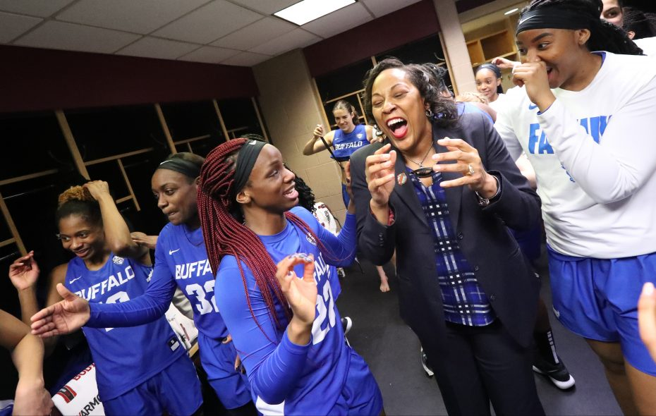 Buffalo coach Felisha Legette-Jack celebrates with her team in the locker room after beating Central Michigan  82-77 to advance to the MAC Championship (James P. McCoy/Buffalo News