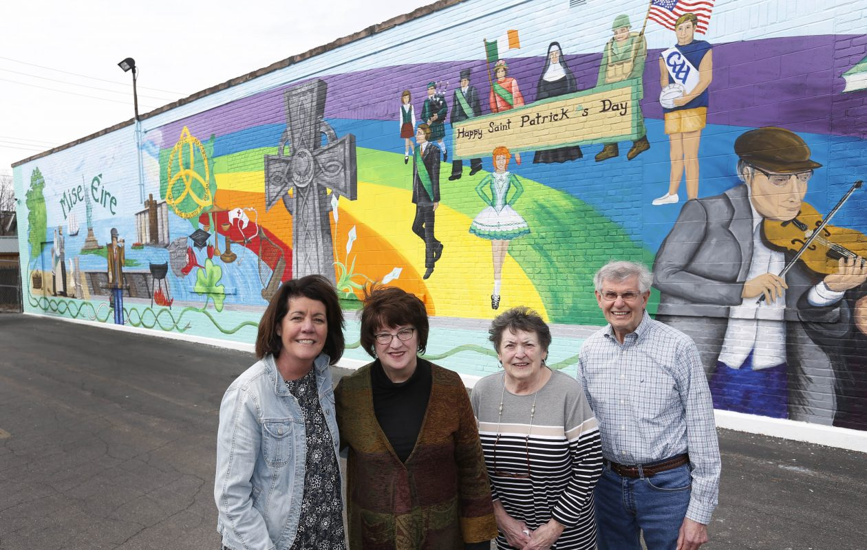 The mural that saved the Buffalo Irish Center: This will be the first St. Patrick's Day with a new mural at the Abbott Road community center whose supporters donated enough money to offset a shattering robbery at the center. From left are Mary Conway Reiser, Mary Heneghan, chairman of the Irish Center, Mary Casey Lynch and her brother Brendan Casey, all part of the core families that helped build Irish heritage in Buffalo. (Sharon Cantillon/Buffalo News)