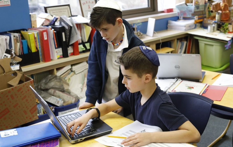 Gabe Epstein, 9, and Nadav Cohen, 10, collaborate on a class project in Chesed (or Kindness) class at Kadimah Academy in Amherst on Friday, March 15, 2019. (Derek Gee/Buffalo News)