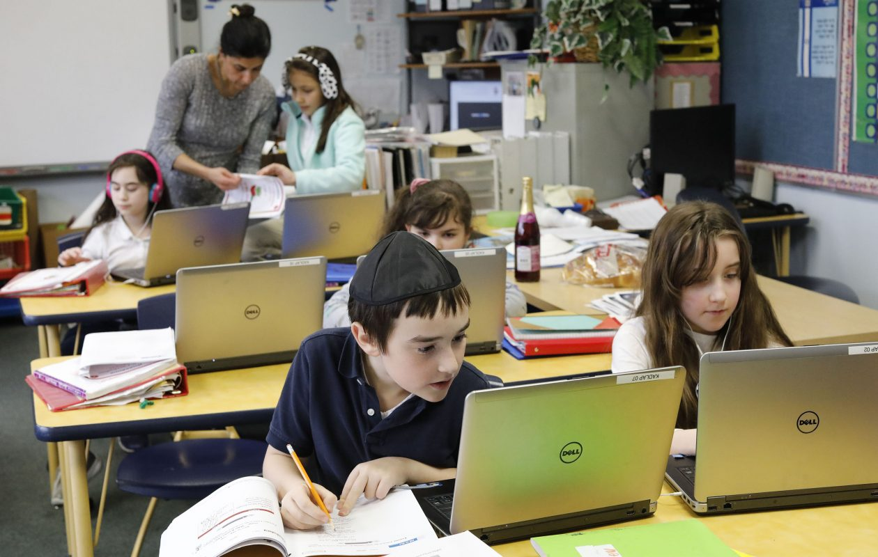 David Brown, 8, and Abigail Shulkin, 10, work on a class project in Chesed (or Kindness) class at Kadimah Academy. The struggling school will partner with the Park School in a creative association that benefits both. (Derek Gee/Buffalo News)