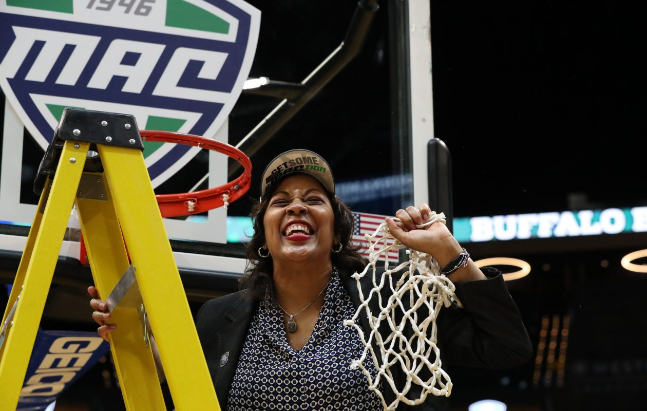 UB Bulls head coach Felisha Legette-Jack cuts down the net after her team won the MAC title. (James P. McCoy/Buffalo News)