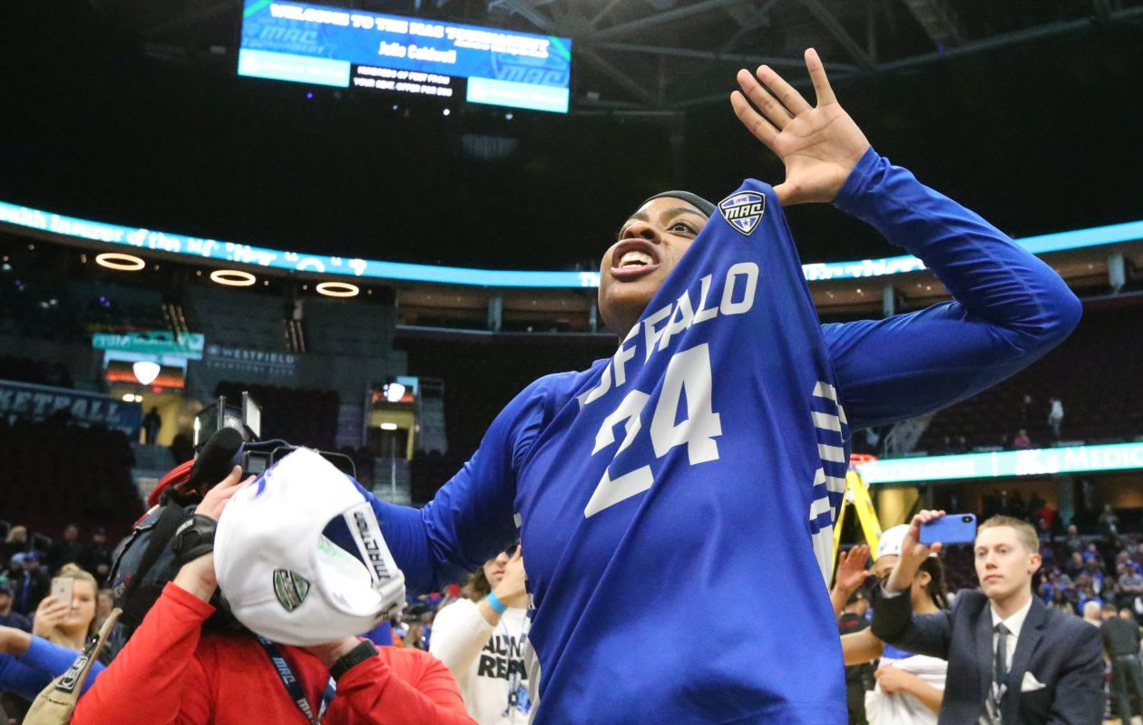 Buffalo guard Cierra Dillard celebrates after beating Ohio to win the MAC championship. (James P. McCoy/News file photo)