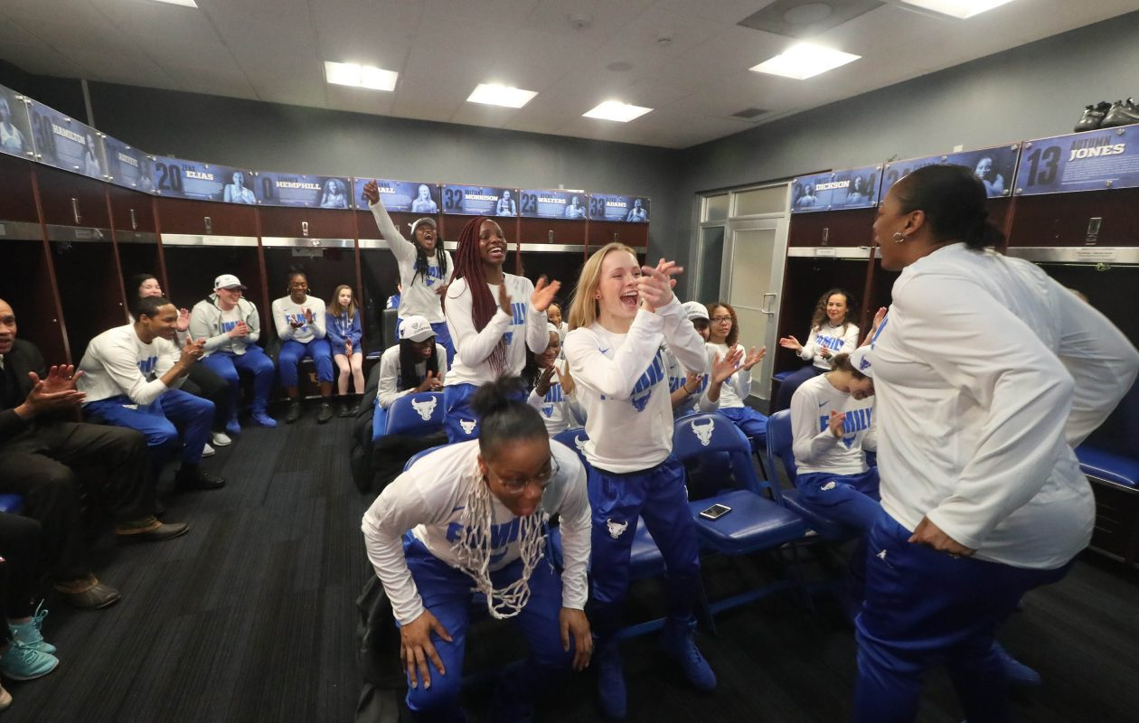 The UB women's basketball team celebrates on Monday, March 18, 2019, after it was announced that they would play Rutgers in the NCAA Tournament. (John Hickey/Buffalo News)