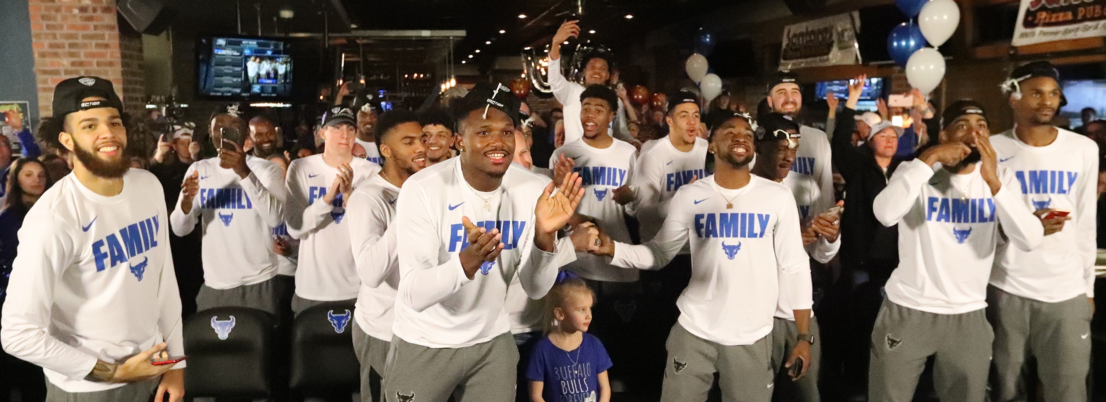 The Buffalo men's basketball team celebrates after learning their NCAA destination (James P. McCoy/Buffalo News)