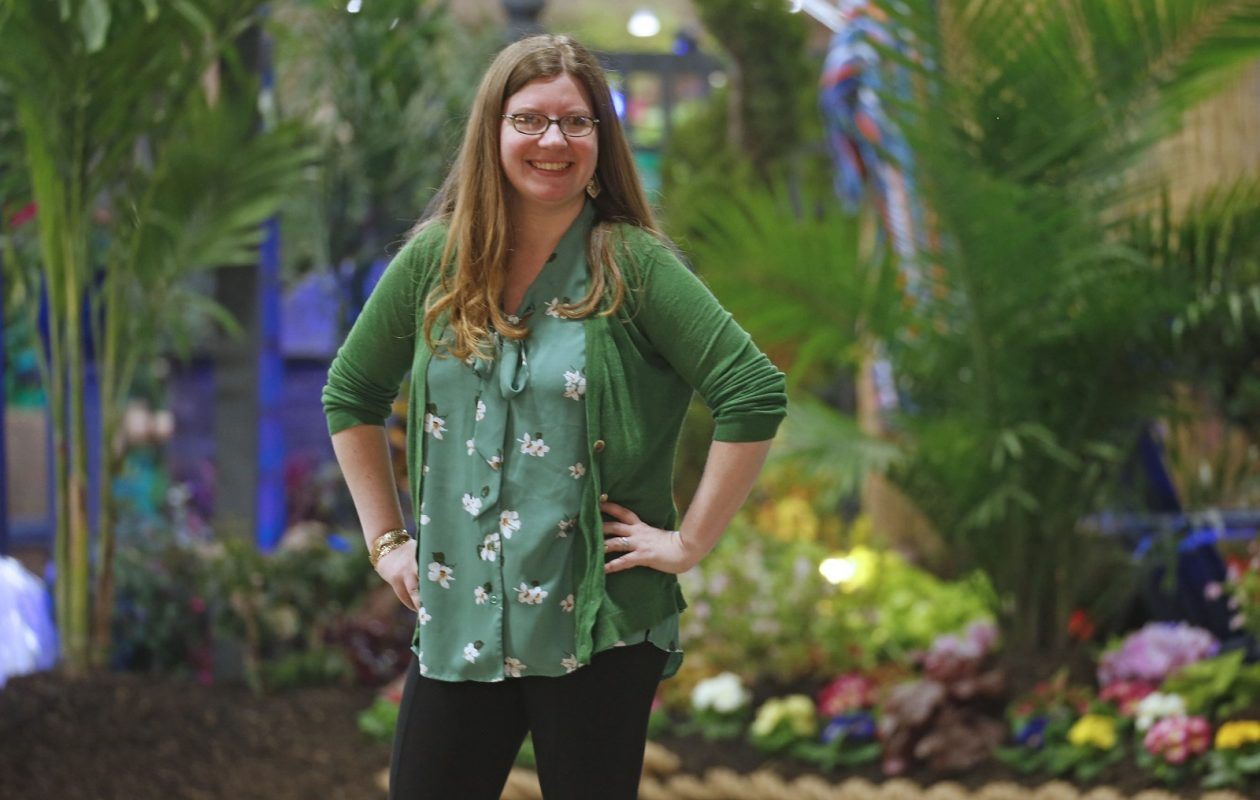 Kristy Schmitt, director of education at the Buffalo and Erie County Botanical Gardens, poses at Plantasia in Paradise, the garden and landscape show that  continues through Sunday at the Fairgrounds Event Center and Artisan Hall in Hamburg. As part of Plantasia, she is welcoming young visitors to the     Children's Garden. (Robert Kirkham/Buffalo News)