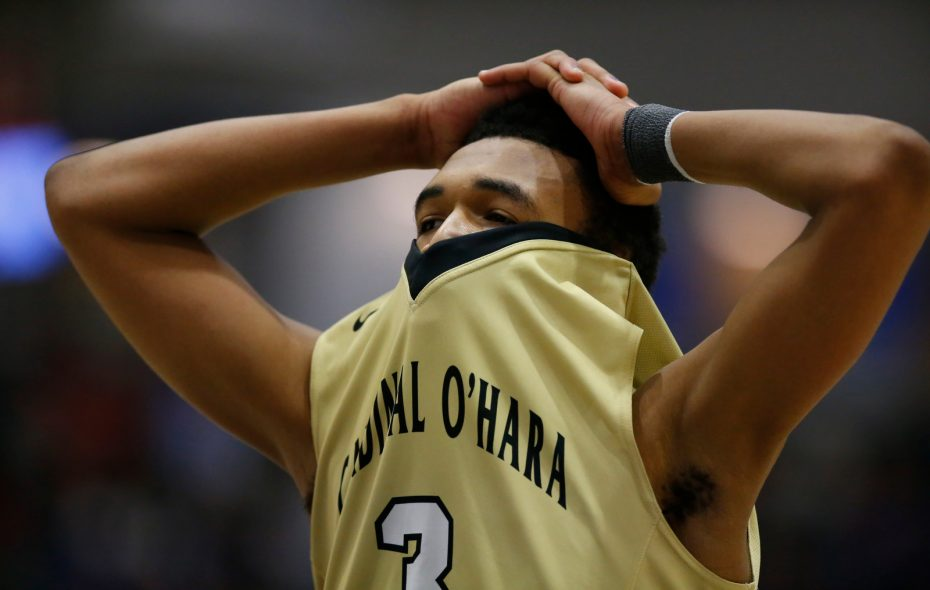 Cardinal O'Hara's Haakim Siner reacts after being whistled for a foul during the Federation Class B final in Glens Falls on Sunday. (Harry Scull Jr./Buffalo News)