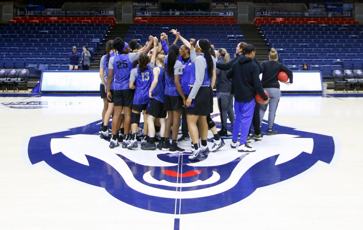 Buffalo players gather a midcourt during practice  at the Harry A. Gampel Pavilion on Thursday, March 21, 2019. (Harry Scull Jr./Buffalo News)