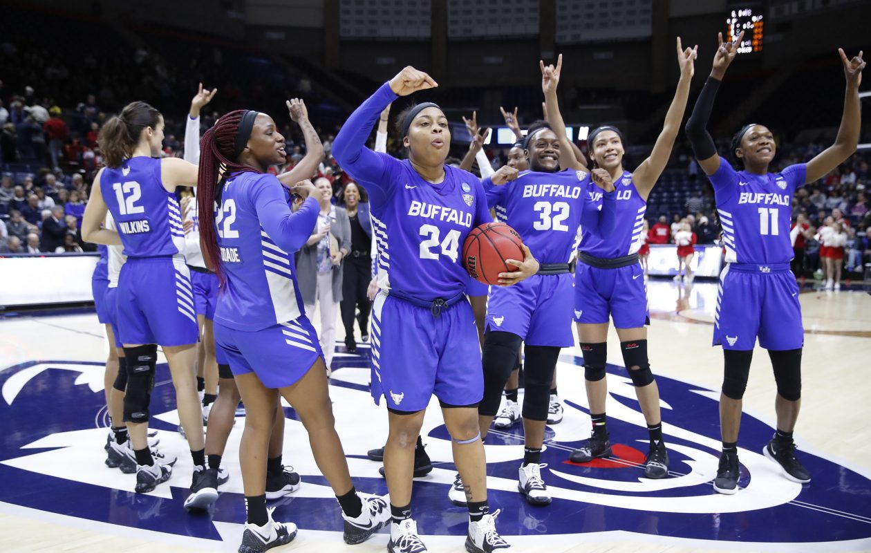 Buffalo players salute the fans after deafeating Rutgers in an NCAA college basketball tournament first round game at the Harry A. Gampel Pavilion on Friday, March 22, 2019. (Harry Scull Jr./Buffalo News)