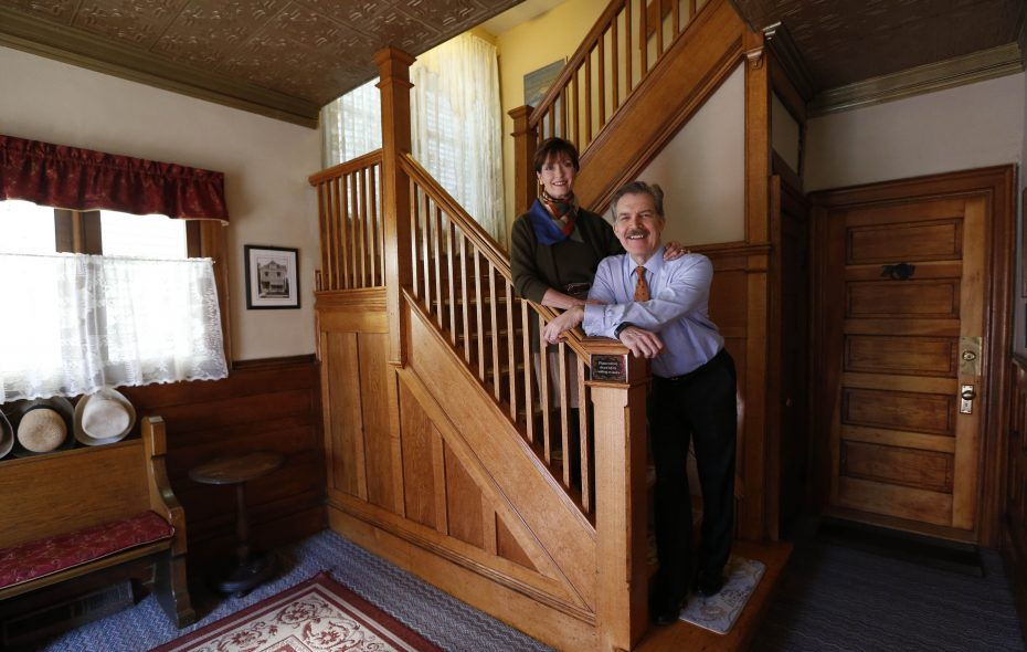 Maria and Tom Tarapacki stand on the refinished staircase at their Elmwood Village home. (Sharon Cantillon/Buffalo News)