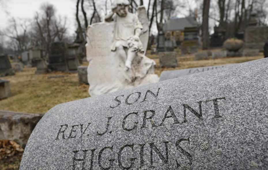 The grave of Monsignor J. Grant Higgins at Holy Cross Cemetery in Lackawanna. When Higgins died in 2016, the Buffalo Diocese tried to make it seem as if he wasn't a priest. (Derek Gee/Buffalo News)