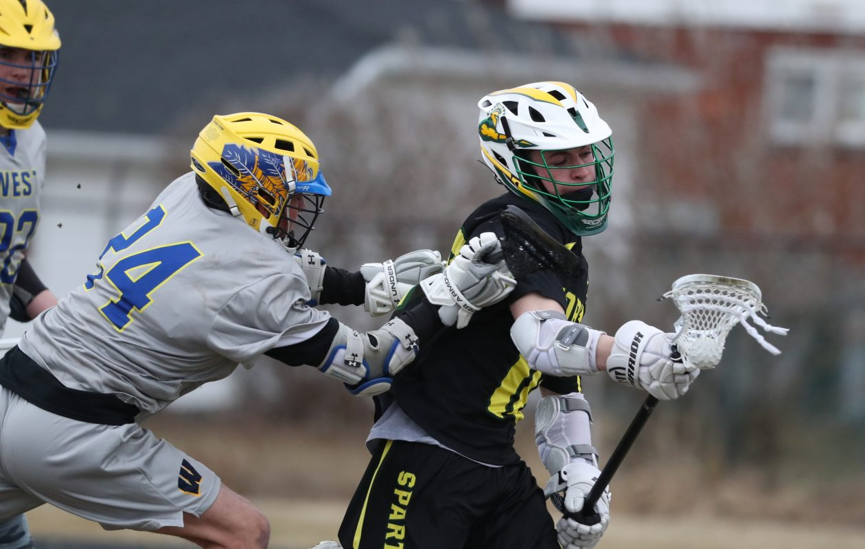 West Seneca West's  Jake Cooper battles Williamsville North Tyler Zeplowitz for possession in North's 8-6 win over the Indians Thursday. (James P. McCoy/Buffalo News)